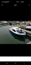 Boat on trailer with 25hp engine