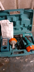 Makita cordless power Drill with two batteries.