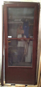 "1 used Storm Door 32"" X 80"" brown- Right Hand Opening"