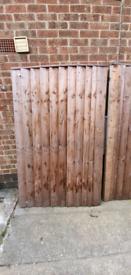 Curved wooden garden gates