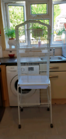 Large white bird cage with stand