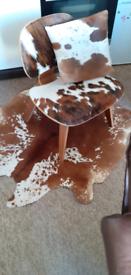 Eames style lounge chair, calf hide rug and cushion