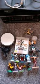 Bundle of skylanders and disney infinity figures and game ps3