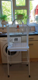 White bird cage and stand