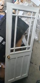 Door with glass paneling