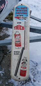 """Vintage """"Trico""""  3ft x8 inch metal wall thermometer."""