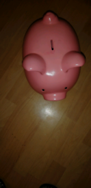 For sale a big pink piggy bank for children or family