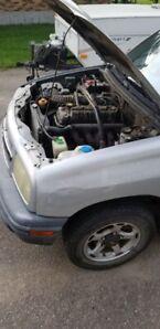 Chevrolet tracker 1999 tél : 581-719-1205