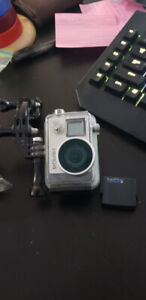 Gopro Hero 4 with extra mounts and spare battery and open back