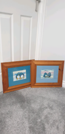 Pair of framed penguin prints, 42x36cm