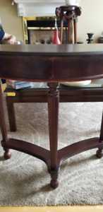 Coffee table and halfmoon accent table. Cherry wood from Bombay.