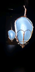 1 mineral hand wrapped with copper ready to hang.