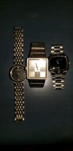 Two Nixon, one Gruen watch.