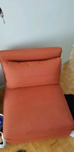 Orange fabric sofa chair with throw pillow IKEA