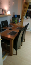 Solid oak four seater dining table and chairs