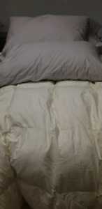 Hutterite homemade goose down pillows and beautiful comforters