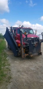 2004 LT9500 STERLING DUMP TRUCK WITH SNOW PLOW AND WING AND SAND