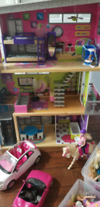 Barbie house, cars, and barbie sets