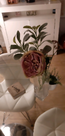 Vase with artificial flowers and artificial plant