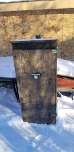 Homemade smoker with a charcoal BBQ in the bottom
