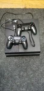 PS4 1TB CONSOLE WITH TWO DUALSHOCK CONTROLLERS