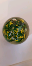 Green and yellow art glass paperweight