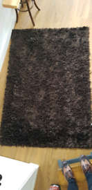 Brown and black rug