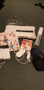 Nintendo wii with fitness accessories