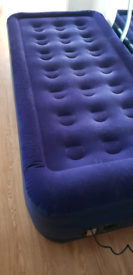Raised height, flocked single air bed with integral pump