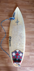 Surfboard with fins and leash 6'2