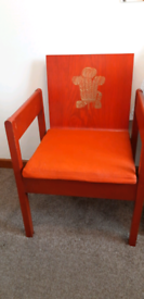 Red investiture chair