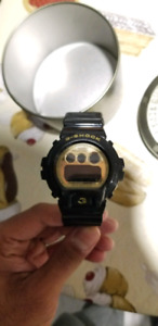 G-Shock black and gold