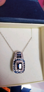 14k white gold natural diamond and sapphire pendant.