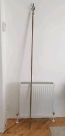 Brass extending curtain pole free