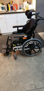 Tilting wheelchair with ROHO seat cushion