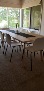 Six-to-eight seater dining table and chairs