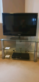 TV, blue ray player and stand.
