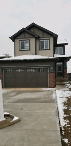 Immediate Possession Suited Home With Oversized Garage!!