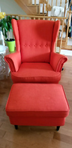 EUC tangy orange high back wing chair with foot stool