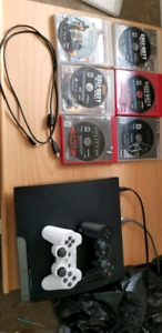 Ps3 slim + 2controllers and 11 games $300 obo
