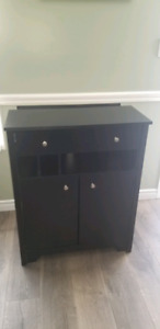 Black cabinet with storage and built in charging station