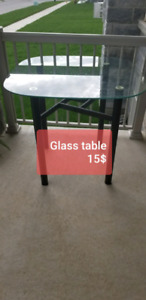 Glass top table with metal base