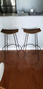 Two brown wicker bar stools rustic farmhouse
