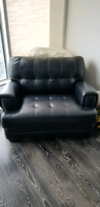 Black leather sofa, oversized chair and ottoman