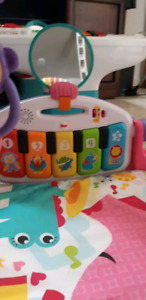 Deluxe kick and play piano gym