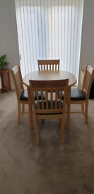 Light oak extending dining table and 4 chairs