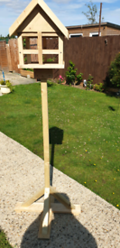 Hand built wooden bird table