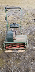 Vintage lawnmower with bager