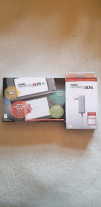 New nintendo 3ds XL + 8 games and protective case