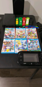Nintendo Wii U with games and controllers